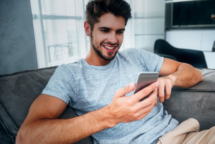 Guy on Couch with Phone